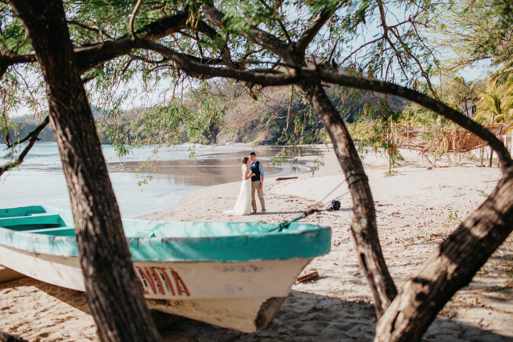 Beach Elopement Wedding with a boat.