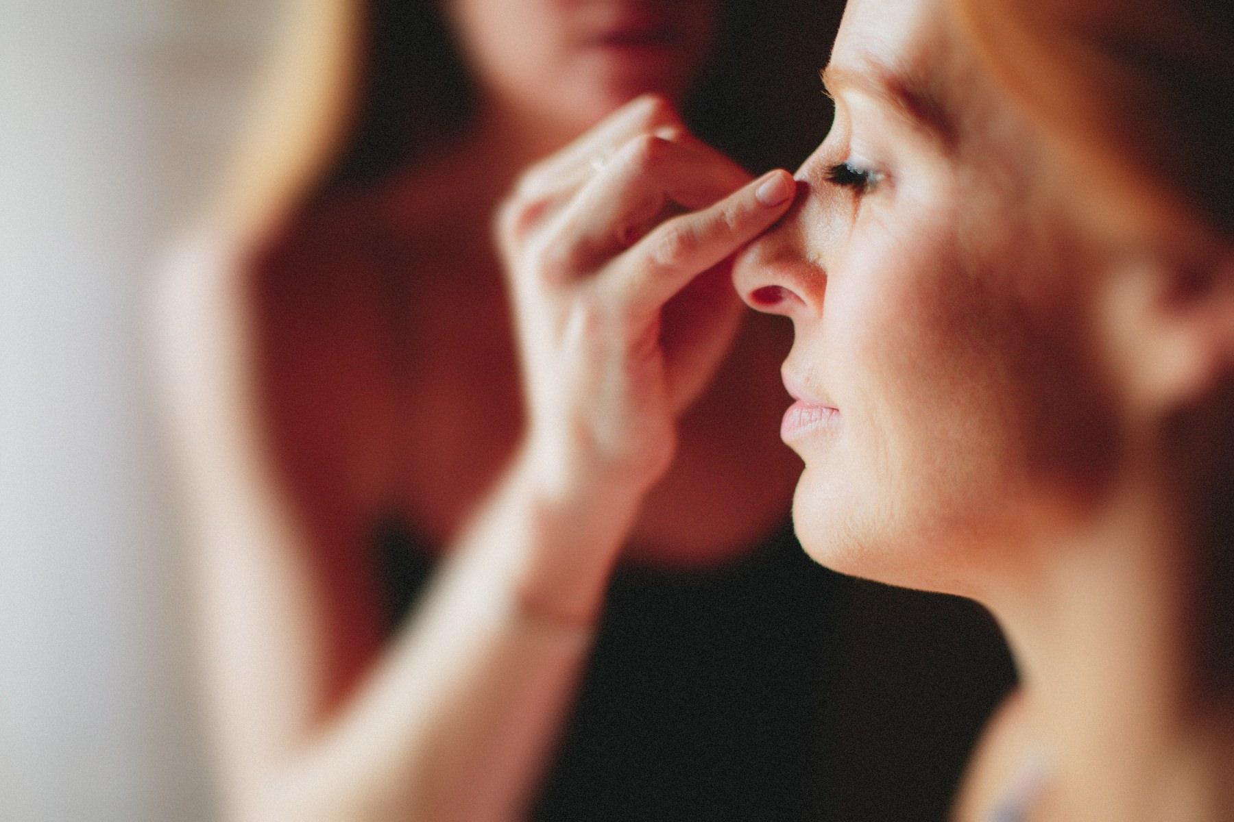 Bride putting make-up