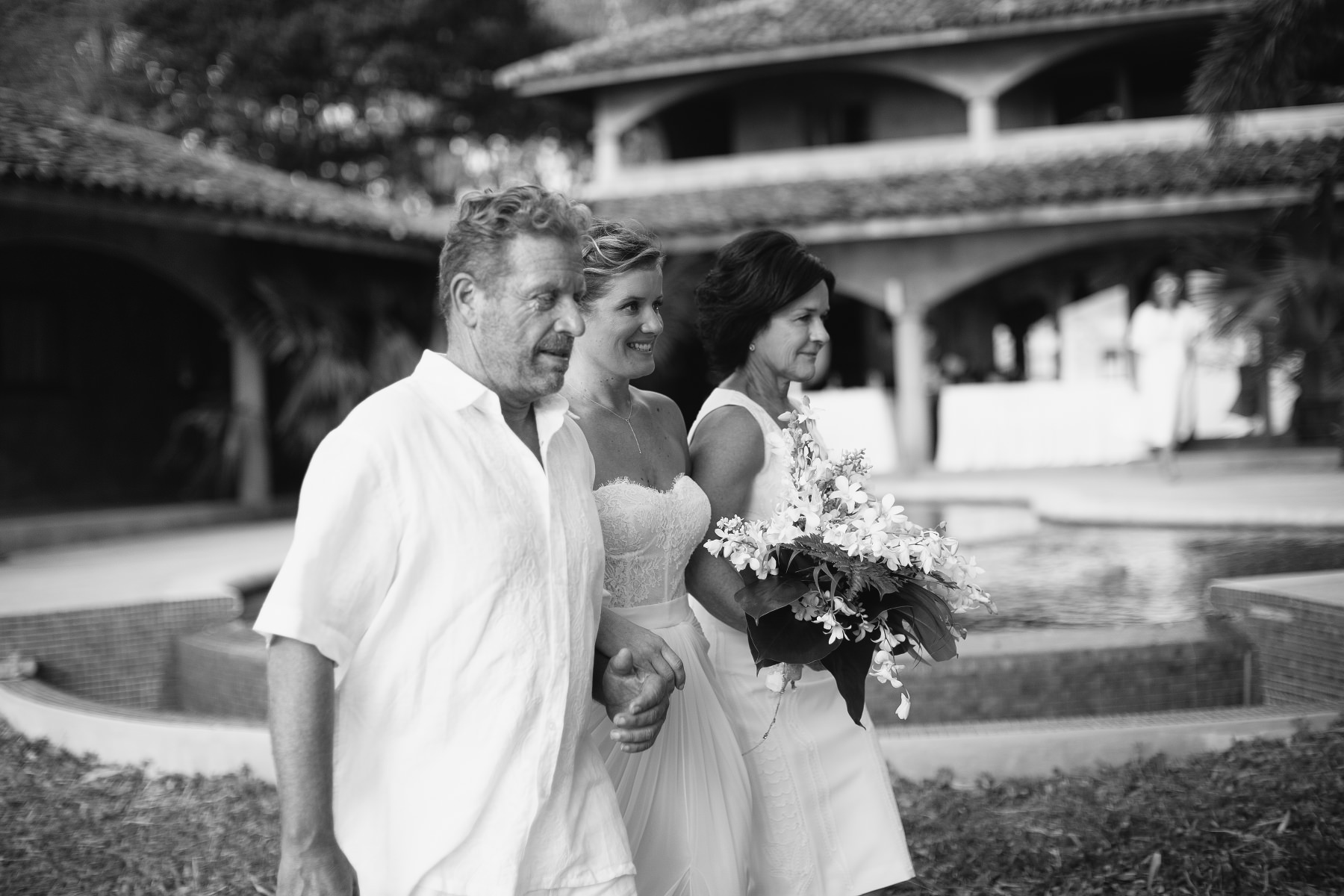 Bride walking with parent black and white photo