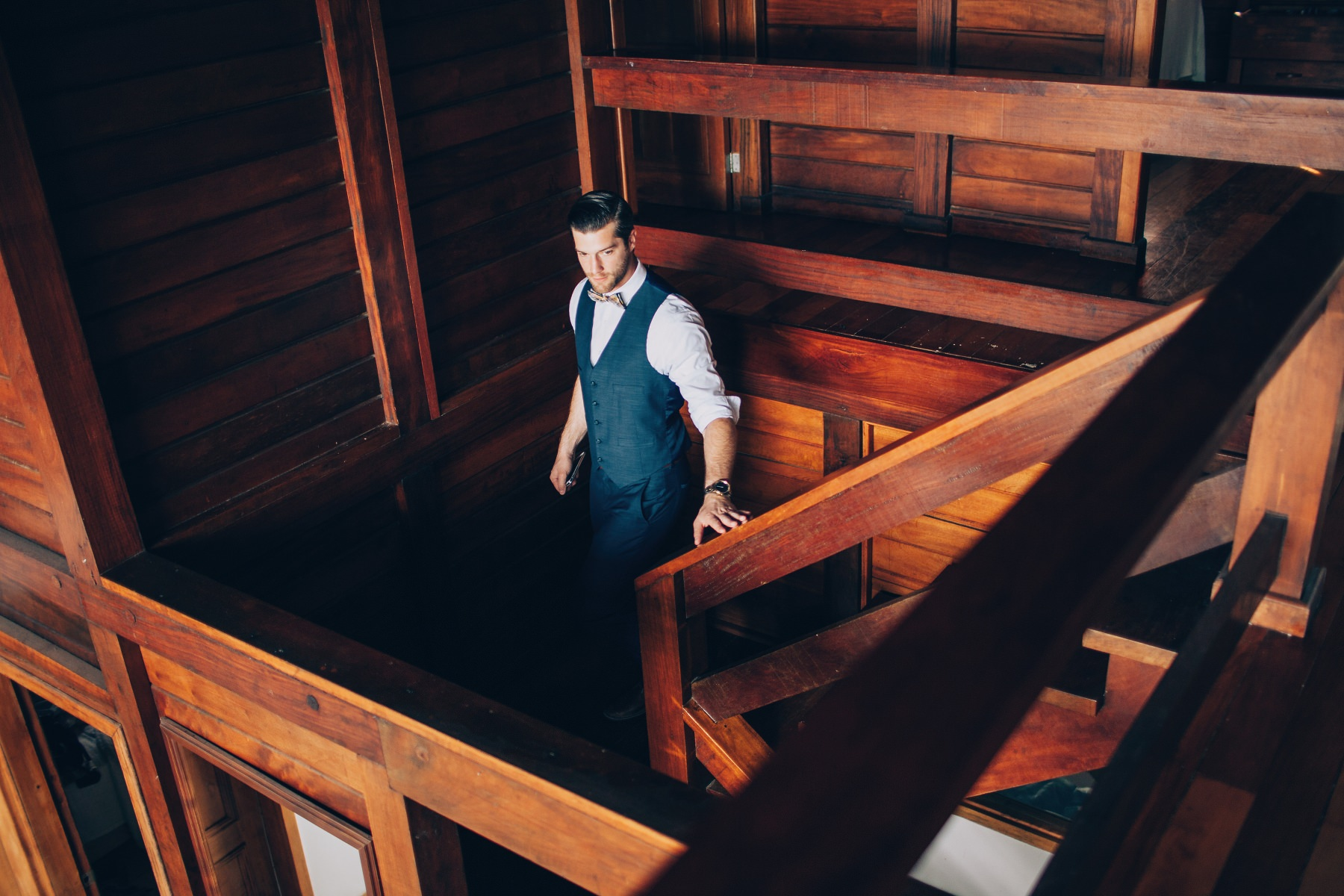 The groom walking down the stairs