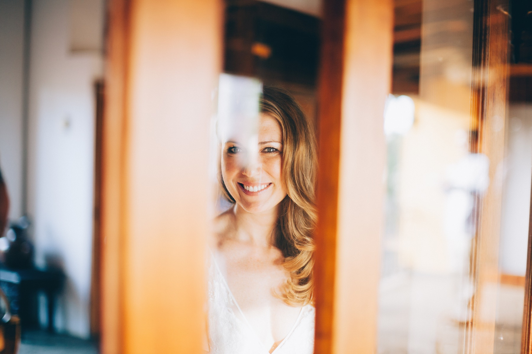 Bride looking through the window - Colonial style destination wedding Mexico - Nicaragua