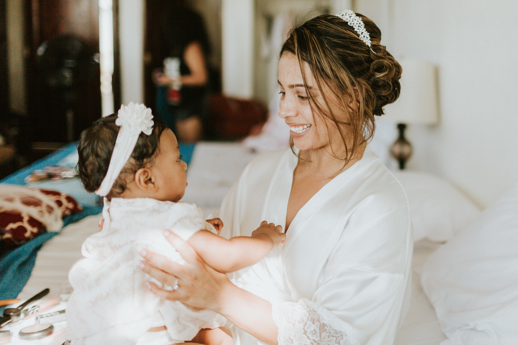 bride with a kid getting ready